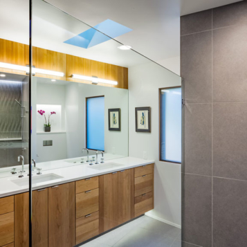 Custom shower and modern wood cabinets