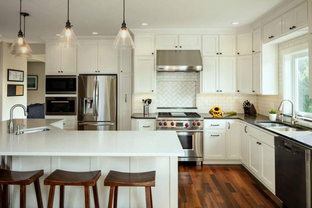 Classic kitchen with white countertops and cabinets