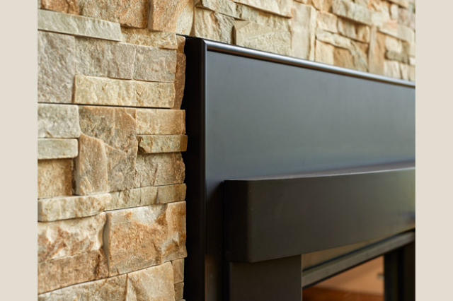 Stone detail around a fireplace in a remodel project by W.L. Construction in Corvallis, Oregon.