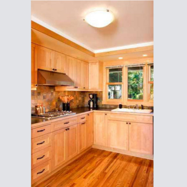 Natural wood is highlighted by dark counters