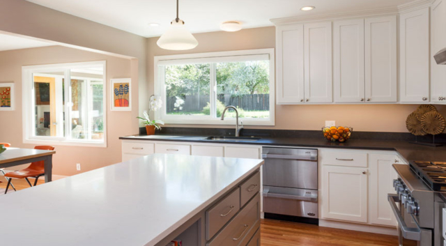 Bright, white kitchen remodel with new windows and custom cabinets by W.L. Construction in Corvallis, Oregon.