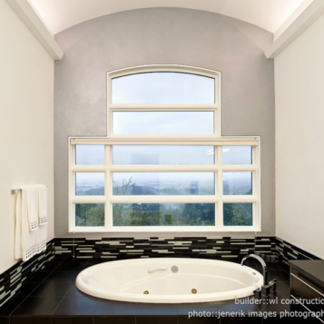 White sunken tub with an amazing view