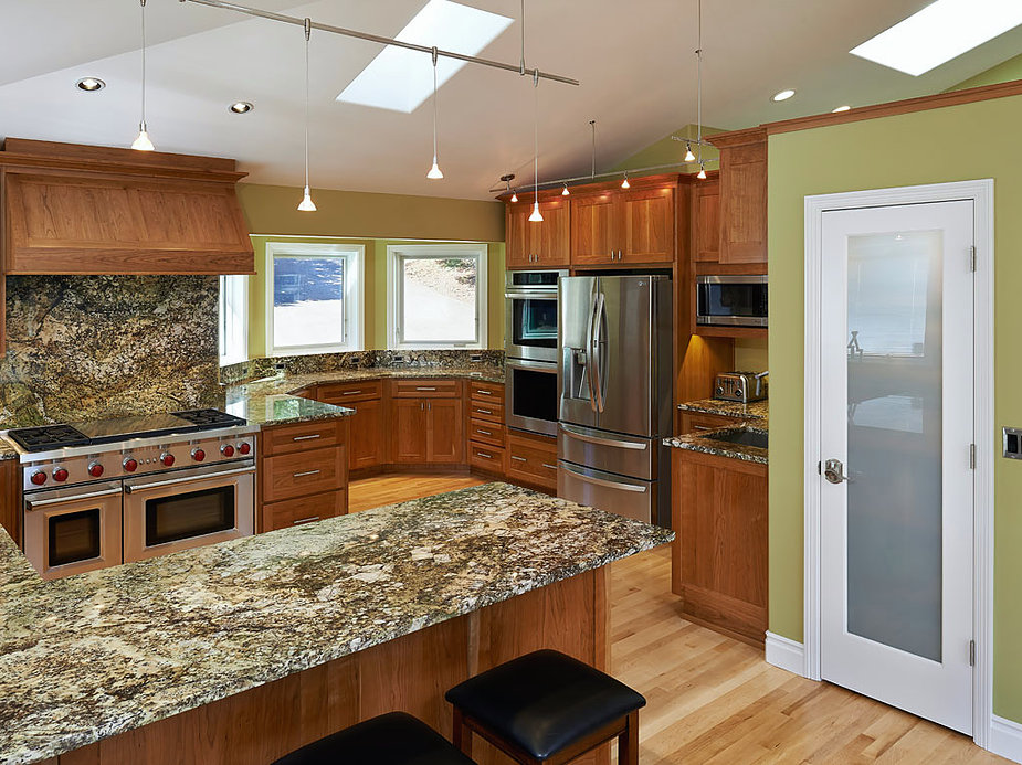 Marble countertops in a circular kitchen nook, as remodeled by W.L. Construction in Corvallis, Oregon.