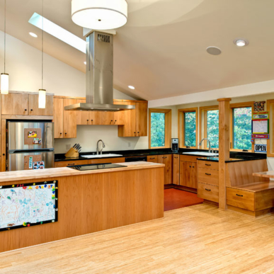 Solid wood cabinets are highlighted by the skylight in this kitchen