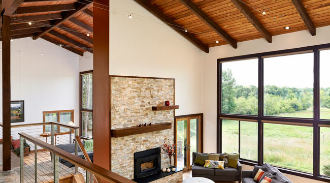 Whole-home remodel took out dated brick and added a new fireplace and brighter interior in this project by W.L. Construction in Corvallis, Oregon.