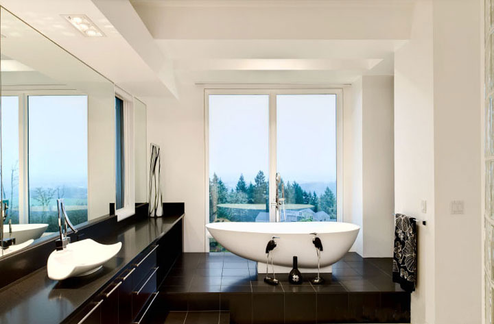 Modern black and white bathroom with tub and vanity