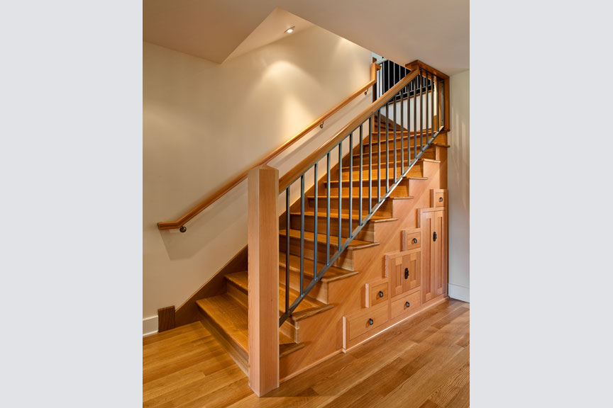 Cabinetry below the staircase is both beautiful and functional.